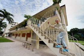 FOLLOW ME: Mr Bilyy Koh, 61, who has lived in this block in Dakota Crescent for 57 years, will be co-guiding walking trails of the estate next month.