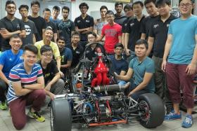 TOP GEAR: NUS FSAE Advisor, Prof Seah Kar Heng (in yellow) and, next to him, on the right Mr Gautham Ramesh, with the NUS FSAE team.