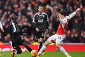 MIDFIELD DYNAMO: Arsenal manager Arsene Wenger calls N'Golo Kante (far left) a 'huge force' for Leicester City.