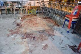 BLOODY: The back of the Teck Whye Lane temple where Mr Tan Poh Huat was found dead.