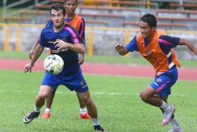COMMITMENT: Nikola Rak (far left) is pursued by Hafiz Nor during training.