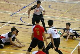BEATEN: Shuqun Secondary School's B boys volleyball team (in white) could not stiop Bukit Panjang Government High School (in red) in yesterday's West Zone final.