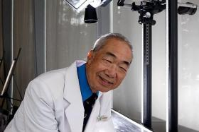 GOING STRONG: Mr Ng Hon Wing now (above).