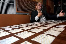 DEDICATED: (Above) Mr Chris Gomez with his collection of ticket stubs to the Star Wars movie.