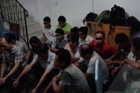 DETAINED: Immigration offenders caught in a raid.