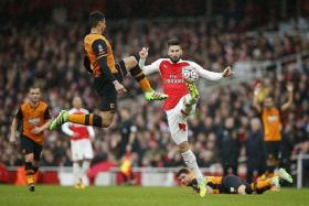 STALEMATE: The gutsy displays of Hull City players like Curtis Davis (far left, challenging Olivier Giroud) giving Arsenal plenty of problems in the 0-0 draw.