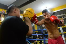 """UNLUCKY: A freak knee injury, midway through the first round of his fight with Malaysia's Ridzuan Dahari, derailed local boxer Syafiq """"The Slasher"""" Abdul Samad's (above) hopes of winning the WBF Asia Pacific lightheavyweight title at SFC 2 last night."""