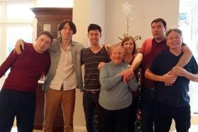BOND: Actor-host George Young (third from left) with his brothers (from left) Paul, Anthony and Andrew, with their grandmother and parents.