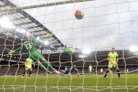 BLUES OPENER: Diego Costa (in blue) putting Chelsea ahead.