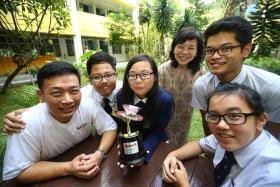 WINNERS: (From left) Beatty Secondary School teacher Alexander Choy, Muhd Zulfazlin Zainal, Chua Hui Min, school principal Marion Tan, Evan Tan Jia Ho and Ang Jia Shing Adeline with their N.E.mation!10 champion trophy.