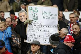 NO GUARANTEE: The fans make their feelings known, but United's problems may not end even if their wishes come true.