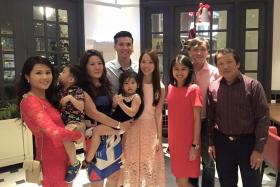 FUN IN THE END: Ms Caryn Lee (left, with her family) went ahead with the wedding dinner when she could not get her restaurant deposit back.