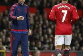 MY MENTOR: Memphis Depay (above) says Manchester United assistant manager Ryan Giggs (left) is helping him get to grips with the Premier League.