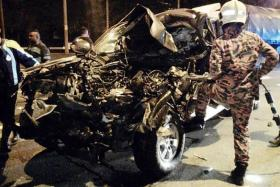 MANGLED: Fire and Rescue Department officers had to use power tools to extricate the body from the wreck of the pick-up truck.
