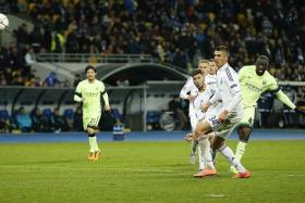 BELTER: Yaya Toure (far right) scores Manchester City's clincher in their 3-1 Champions League win over Dynamo Kiev.