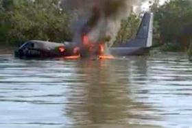 ENGINE FAILURE: The plane crashed near a swampy beach and one of those who went to help drowned after getting stuck in the mud.