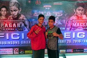POWER PACKED: Singapore boxer Ridhwan Ahmad (left) will be facing Melchor Roda (right), who has won all his three professional bouts by knockout.