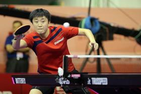 SINGAPORE WOMEN PADDLERS: Feng Tianwei (above) and Yu Mengyu during a training session.