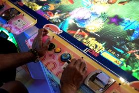 NO CHILD'S PLAY: Senior players sitting around the consoles in arcades is becoming a common sight.
