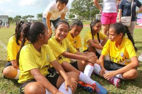 VIP VISIT: Minister Grace Fu chatting with the girls who attended yesterday's Women's Football Day.