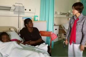 CONCERNED: Assemblywoman Lee Kee Hiong visiting one of the seven students who was hospitalised.