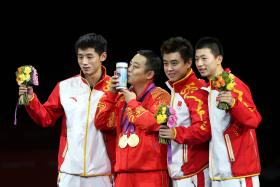 LEAGUE OF THEIR OWN: Liu Guoliang (second from left) celebrating the men's team gold medal with his players at the 2012 London Olympics.