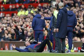 """Louis van Gaal's """"dive"""" while protesting to fourth official Mike Dean during Man United's win over Arsenal has taken the Internet by storm."""