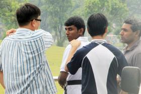 Sumanthiran Selvarajoo (centre) was jailed 16 years and sentenced to receive 12 strokes of the cane after he attacked and killed an elderly man with an umbrella at Ang Mo Kio park in 2011.