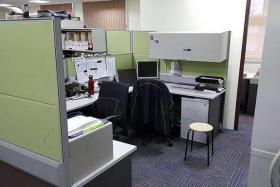 INTERVIEW: The open plan office at an Ang Mo Kio police station where an investigation officer interviewed Benjamin Lim. The officer sat at his desk (middle), while Benjamin sat on the stool. Another investigation officer, who is unrelated to the case, sat at the desk on the left.