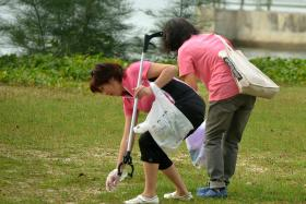 CONTRIBUTING: Volunteers picking up litter at East Coast Park.