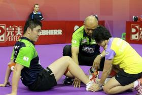 IN NEED OF REST: Gao Ning (above, left), who injured a tendon in his right foot in the 3-2 Group C loss to Poland at the World Team Table Tennis Championships last Sunday, was sent home yesterday to rest.