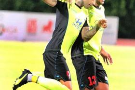 THRILLED: The crowd of 3,551, the biggest turnout this season, witnessed a sublime free-kick from Tampines' Jermaine Pennant (left) and a superb strike from Ken Ilso of Home United.