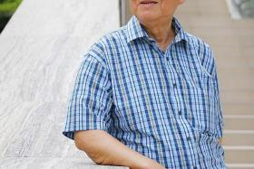 FORTUNATE: Mr Michael Lim found out he had colorectal cancer in time to treat it.