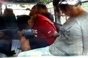 ACCUSED: Benjamin Ling Jialiang, Judy Wee Aye Fong and and Fong Ling Ling (above, in red) allegedly tried to extort $346,000.