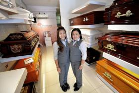 FULFILLING: (Above) Miss Joan Chan, 23, works frontline operations at Ang Chin Moh Funeral Directors while Madam Julie Tan, 45, helps to organise funerals.