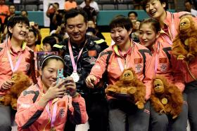 I hope the other teams raise their levels for the Olympics. It would be good for table tennis and the fans as well. — Coach Kong Linghui (left, in black, with the Chinese women's team)