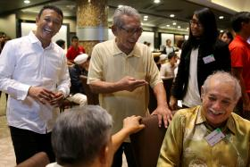 FONDLY REMEMBERED: Hussain Aljunied (above) sharing a light moment at a tribute dinner for Singapore's sporting pioneers at the Sports Hub in 2014.