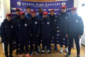 MAKING MOVES: (Above) Faurlin and Nedum Onuoha (without caps) welcoming eight footballers from Asia, including Singapore's Effan Putra Ibrahim (far right) and Nuruddin Irsyad Samion (fourth from right), to QPR for a stint.