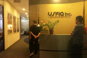 Staff members at USFIA Singapore manning the reception area.
