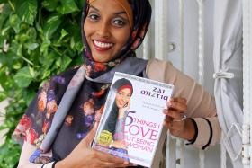 INSPIRING: Ms Zaiton Majeed posing with the book she wrote, 5 Things I Love About Being A Woman.