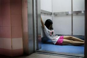 URGENT: Ms Evi Lisnawati showing how she spent the 1½ hours in the lift pressing the emergency button.