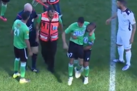 After medics dropped the injured player off the stretcher, he decided it was safer to make it off on his own, with some help from his captain.
