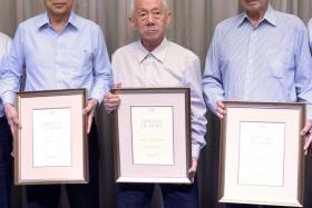 AWARD RECIPIENTS: From near right, Chris Chan, Tan Howe Liang and Tan Eng Liang are honoured for their contributions to the Olympic movement.