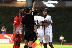 MARCHING ORDERS: Warriors' Madhu Mohana (far right) was sent off for allegedly swinging an arm at Home United forward Irfan Fandi last month.