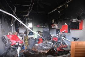 GONE: (Above) The walls of the living room and its contents were charred. The police have classified the fire as a case of unlicensed money-lending harassment.