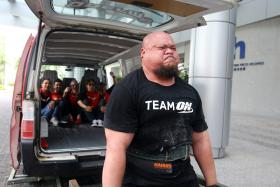 POWER: Mr Ahmad Taufiq Muhammad lifted a van five times as ONE FM's #1 Breakfast Show crew members Elliott Danker, The Flying Dutchman, Shaun Tupaz, Andre Hoeden and Glenn Ong got into it one after the other.
