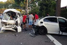 CRUSHED: (Above)The accident on Ayer Rajah Expressway involved a car, a van and a private bus.