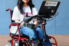 MOVING AROUND: Miss Wang Jinyu has developed a programme to control a wheelchair with eye gestures.