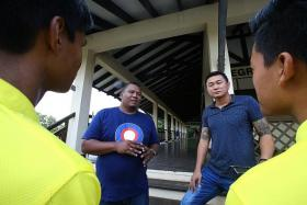 ADVICE: Former gang members Azmi Abdul Rahman (left) and Kim Whye Kee (right) speaking to participants of Camp ACE VIII.
