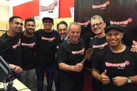 BONDING: Celebrity chef Wolfgang Puck (holding the spoon) with his business partner Alex Reznik and the ONE FM's #1 Breakfast Show team.